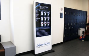 Schools open halls to electronic billboards