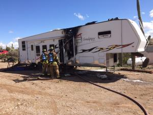 Travel trailer burns on NW property