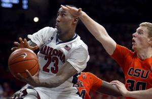 Photos: No. 6 Arizona 57, Oregon State 34