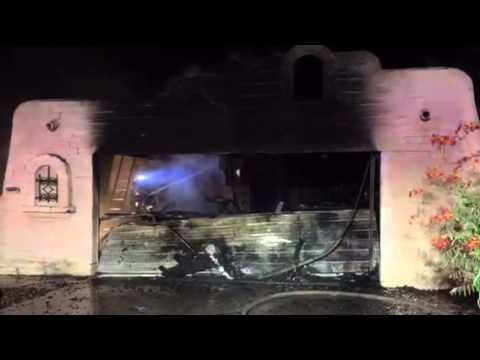 Three displaced in early morning garage fire