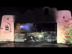 Three displaced after garage fire spreads to house
