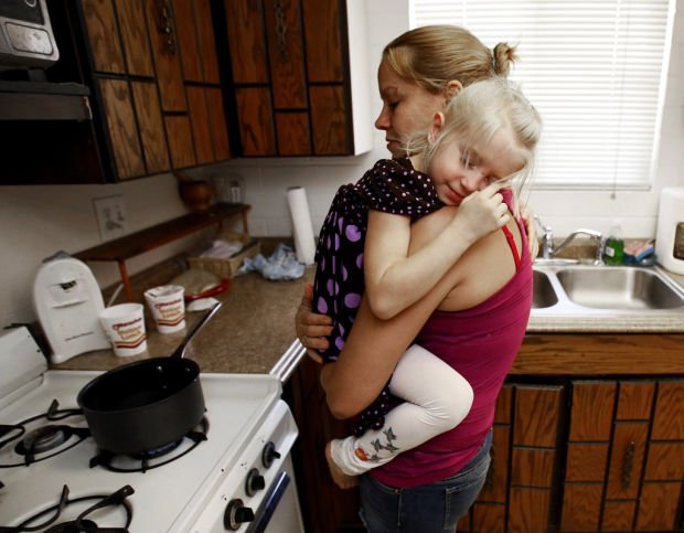 Special report: Young moms, kids barely making it
