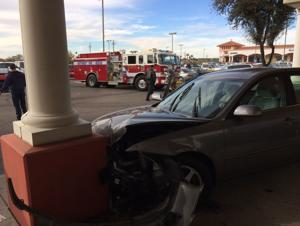 Woman's car hits column outside Tucson business