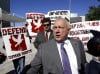 SB 1070 author Pearce may miss immigration law's day in court
