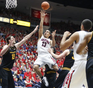 Arizona Wildcats defeat ASU 73-58