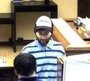 Police seeking suspect in east side bank robbery