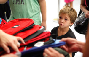 Photos: Flowing Wells backpack giveaway