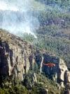 Tamer winds let firefighters make progress, provide hope