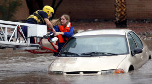 Woman trapped in car by rushing water
