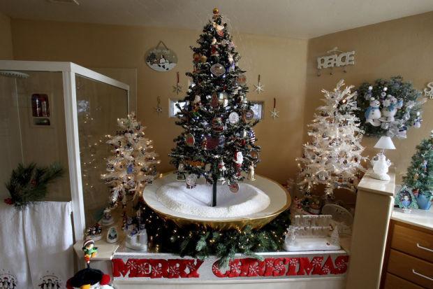 couple displays 100 christmas trees in their sahuarita home