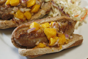 Top turkey dogs with quick mango relish