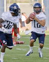 The 2014 Arizona Wildcats starting quarterback battle