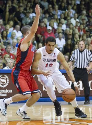 Arizona beats San Diego State 61-59 in Maui final