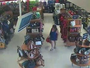 Woman linked to purse thefts