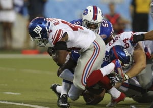 RB Williams sparks Giants to Hall of Fame win
