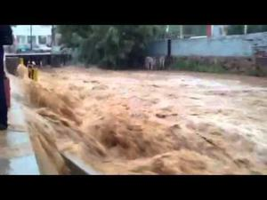 Rainfall fills wash in Nogales