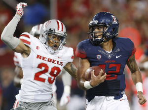 Arizona tops UNLV 58-13