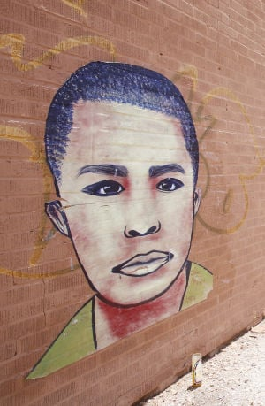 Neto's Tucson: 2 faces on west-side Tucson wall are quiet, tragic reminders