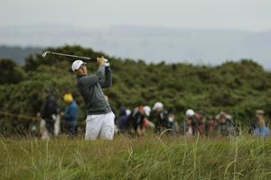 Johnson muscles way to 65; US Open nemesis Spieth is 2 back