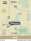 Brush fire burns two structures south of Tucson