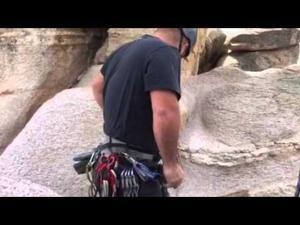 Climbing a sheer rock pinnacle