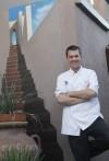 Chef deftly handles food, people, flames