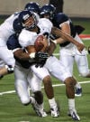 The 2014 Arizona Wildcats starting quarterback battle