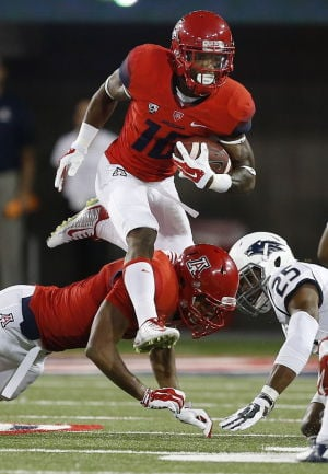 UA football notes: Trusty Grant back in fold