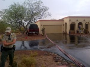 Storm damages Tucson school, lightning may be cause of house fire