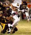 High school football: Big brother big part of QB Cota's success
