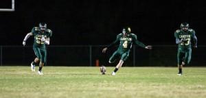 Dorados Post 56 Points… In A Half : Randy Metcalf/The Explorer,  CDO kicker Tilghman Harvy kicks off after a Dorado touchdown as Andy Carter, 50, and Mike Smith head towards the ball receiver.