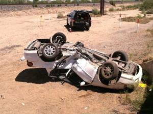 Northwest Fire extracting rollover victim on frontage road