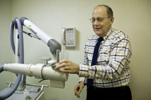 Saguaro Dermatology: Dr. Haraldsen shows how to put together a part on the new radiation treatment machine. It is a non-surgical machine and is the only one in Tucson. - Hannah McLeod/The Explorer