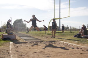MHS Track: Crystal Padilla takes her shot at the long jump at Marana High School's track meet against Sabino and Cienega High School.  - Hannah McLeod/The Explorer