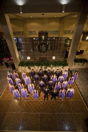 Hilton El Conquistador Tree Lighting Ceremony: The Canyon Del Oro High School choir performs during the tree lighting festivities at the Hilton in Oro Valley. - Randy Metcalf/The Explorer