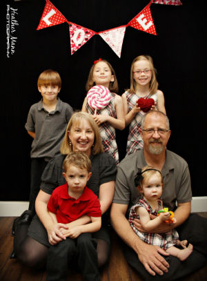 FamiyPhoto2013.jpg: This is the most recent photo of the Freeman family. Benjamin (left) is now nine, Abby (middle) is six and Libby (right) is eight. - Heather Mann