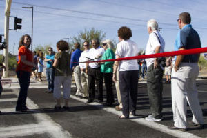 Lambert Lane: Staff and officials with the Town of Oro Valley gather in front of a ribbon during a ribbon-cutting ceremony on June 21 for the completion of the Lambert Lane road project. - Randy Metcalf/The Explorer