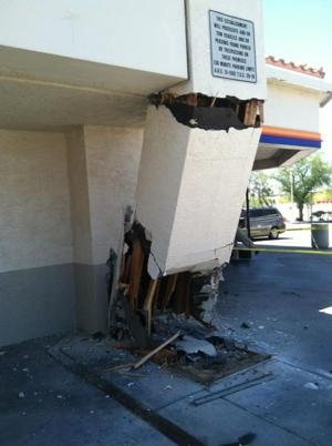 Car crashes into AMPM