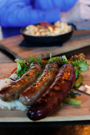 Noble Hops: TheappetizerBanger Kabobs is a selection of two brats and one quite spicy Italian sausage. It comes with a sauerkraut salad and Noble Hops' signature Champagne stone ground mustard.  - Randy Metcalf/The Explorer