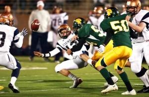 Not Done Yet  : J.D. Fitzgerald/Special to The Explorer, Mikel Kanoza of CDO takes down Cienega quarterback Jordan Mills.