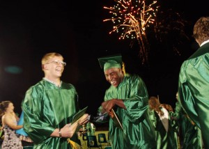 CDO Graduation 1: Canyon Del Oro High School seniors Ka'Deem Carey, right, and Carson Martin rejoice after the graduation ceremony Monday night. The two were among the 405 students to graduate. - Randy Metcalf/The Explorer