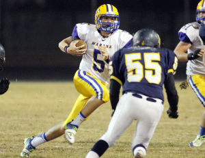 Marana Vs Flowing Wells Football: Ben Honea drives the ball down the field during the third quarter. - Randy Metcalf/The Explorer
