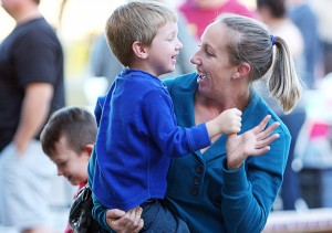 Marana Holiday Tree Lighting: Melissa Cook dances with her 4-year-old son Ryan as holiday music plays in Marana.  - Randy Metcalf/The Explorer
