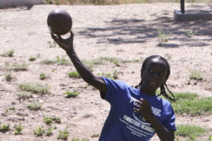 PRCA Football Camp: Evan Lovett, 10, throws the football during a passing drill at the sports camp put on by Pusch Ridge Christian Academy. Evan is the son of Lamar Lovett, assistant varsity football coach and one of the people who helped out at the camp. - Hannah McLeod/The Explorer