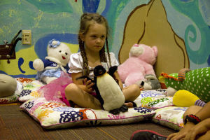 Tu Nidito: Presley Gyuro play with a stuffed animal penguin as she sits in on the little's group at Tu Nidito. - Hannah McLeod/The Explorer