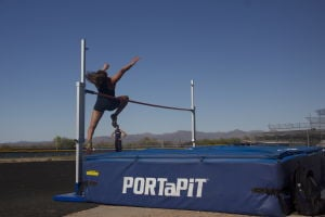 MHS Track: Sydney Madrid, a junior on the Marana High School track team flies over the high jump. Madrid won the event with a final jump height of 4'8.  - Hannah McLeod/The Explorer