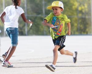 Painted Sky Elementary School's Miler's Club: Dylan Dirtadian, 6, runs before school last week.  - Randy Metcalf/The Explorer