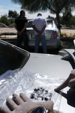 Police nab 2 in heroin bust