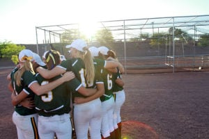 Canyon Del Oro Vs Salpointe Softball: The Canyon Del Oro softball team gathered together before its playoff game against Salpointe.  - Randy Metcalf/The Explorer