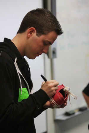 NASCAR Racecar Driver Alex Bowman: Alex Bowman signed autographs on Ironwood Ridge students' shoes, shirts, driver's licenses and pieces of paper.  - Randy Metcalf/The Explorer